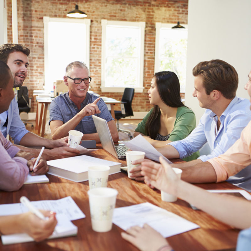 Group Of Office Workers Meeting To Discuss Ideas